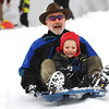 Douglass Johnson and his son McEwen Johnson Hernandez, 4, share a ride at Scott Carpenter Park in Boulder, Colorado  after a winter snowstorm.<br /> Photo by Paul Aiken / The Camera / February 3, 2012
