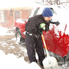 Jamey Archer pauses while digging out his truck as a wind gust blows across the driveway at his home on Midway Blvd. and Kohl St. in Broomfield during the February 3rd snowstorm.<br /> February 3, 2012<br /> staff photo/ David R. Jennings