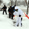 "Oscar Cortez, right, leads a group of workers clearing the sidewalks along Ken Pratt  Blvd in Longmont Friday morning.<br /> For more photos of the snow, go to  <a href=""http://www.dailycamera.com"">http://www.dailycamera.com</a>.<br /> February 3, 2012 / Cliff Grassmick"