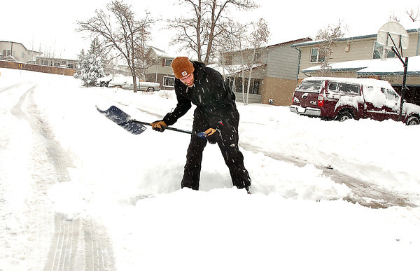 Chad Kohlmeyer clears a path to the street from his driveway on Laurel Street in Broomfield during the February 3rd snowstorm.<br /> February 3, 2012<br /> staff photo/ David R. Jennings