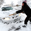 Anna Johnson digs out her car in Boulder, Colorado  after a winter snowstorm.<br /> Photo by Paul Aiken / The Camera / February 3, 2012