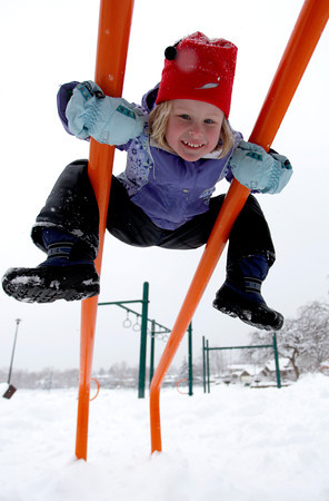 Imogene Gaede, 5 years old, spends the afternoon playing in the snow covered play ground at Boulder North Park, Feb, 3, 2012, Boulder. <br /> <br /> Photo By Derek Broussard
