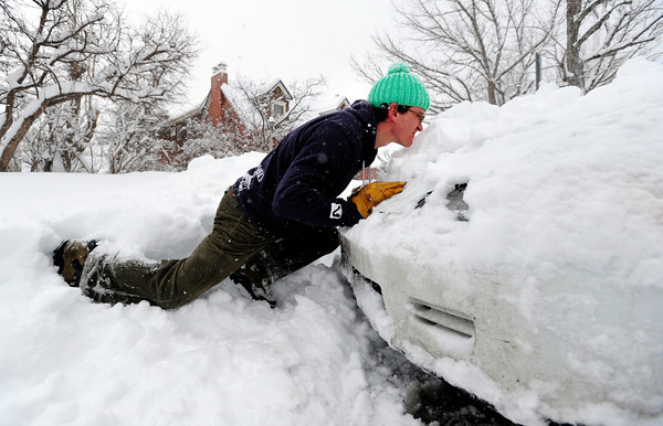 Matt Bataglia helps a neighbor get his car unstuck on University Hill in Boulder, Colorado  after a winter snowstorm.<br /> Photo by Paul Aiken / The Camera / February 3, 2012
