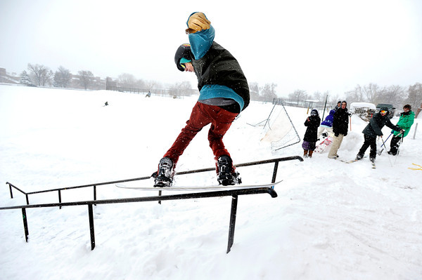 """Hayden Spriggs, 19, of Boulder, grinds a rail while his friends watch  on Friday, Feb. 3, at New Vista High School in Boulder. For a video of the rail jam go to  <a href=""""http://www.dailycamera.com"""">http://www.dailycamera.com</a><br /> Jeremy Papasso/ Camera"""