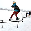 "Hayden Spriggs, 19, of Boulder, grinds a rail while his friends watch  on Friday, Feb. 3, at New Vista High School in Boulder. For a video of the rail jam go to  <a href=""http://www.dailycamera.com"">http://www.dailycamera.com</a><br /> Jeremy Papasso/ Camera"