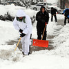 "Oscar Cortez, left, leads a group of workers clearing the sidewalks along Ken Pratt  Blvd in Longmont Friday morning.<br /> For more photos of the snow, go to  <a href=""http://www.dailycamera.com"">http://www.dailycamera.com</a>.<br /> February 3, 2012 / Cliff Grassmick"