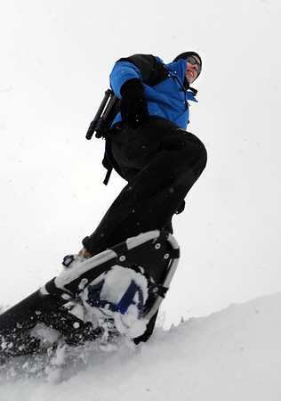 "Tony Sands goes snowshoeing at Chautauqua Park on Friday, he was given the day off at work.<br /> For a video of the snow, go to  <a href=""http://www.dailycamera.com"">http://www.dailycamera.com</a>.<br /> Cliff Grassmick / February 3, 2012"