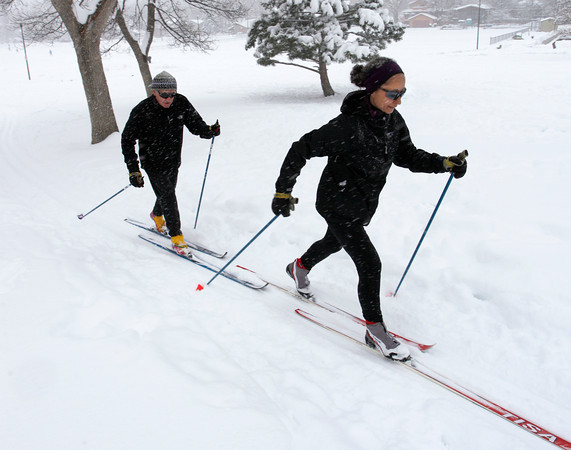 Jerry Fahy, left, and Deborah Hollis, right, takes the afternoon to cross-country ski around Boulder North Park, Feb, 3, 2012, Boulder. <br /> <br /> Photo By Derek Broussard