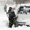 "Mary Pascua works hard to remove snow around her family's vehicle in Longmont on Friday.<br /> For more photos of the snow, go to  <a href=""http://www.dailycamera.com"">http://www.dailycamera.com</a>.<br /> February 3, 2012 / Cliff Grassmick"
