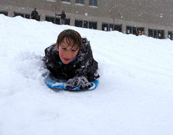 Banyon Lyon, 7, sleds down the hill behind Casey Middle School, Feb. 3, 2011, Boulder.<br /> <br /> Photo By Derek Broussard