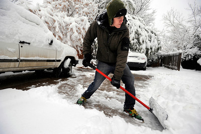 Peter Van Atta works to clear his driveway in Boulder on Wednesday morning. Photo by Paul Aiken / The Camera
