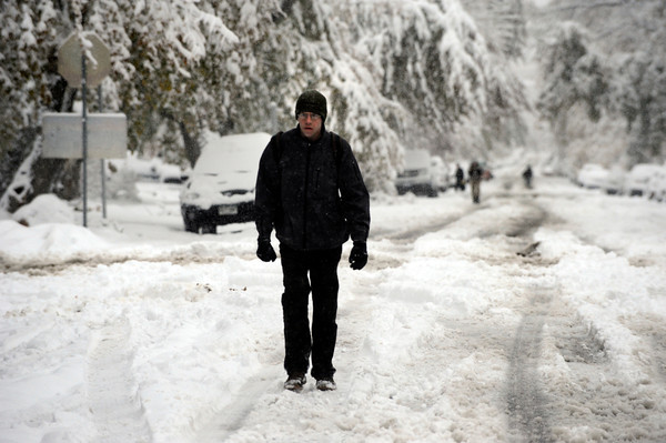 A man who ask not to be identified takes a snow walk up a quiet street on Wednesday morning on University Hill in Boulder.<br /> Photo by Paul Aiken / The Camera