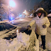 SNOW.JPG SNOW<br /> Angelique Espinoza clears snow from her car in downtown Boulder on Tuesday night.<br /> <br /> PHOTO BY MARTY CAIVANO<br /> Nov. 1, 2011