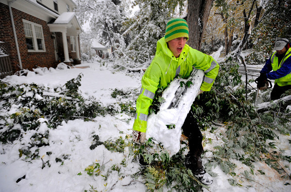 Mitch Buthod of the city's Forestry Department clears one of many large limbs to fall in the yard of a home on Mapleton Hill in Boulder.<br /> Photo by Paul Aiken