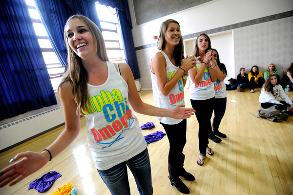 """Sorority member Bri Morris, left,  sings a sorority song in the Glenn Miller Ballroom on the CU Boulder Campus Wednesdy evening on Sorority Bid Day. FOR MORE PHOTOS AND A VIDEO OF BID DAY GO TO  <a href=""""http://WWW.DAILYCAMERA.COM"""">http://WWW.DAILYCAMERA.COM</a><br /> Photo by Paul Aiken / The Camera / September 7, 2011"""