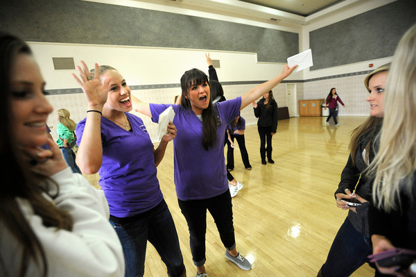 """Sorority member Molly Williams, left and Caitlin<br /> Carlson welcome a group of bidding CU students at the Glenn Miller Ballroom on the CU Boulder Campus Wednesdy evening on Sorority Bid Day. FOR MORE PHOTOS AND A VIDEO OF BID DAY GO TO  <a href=""""http://WWW.DAILYCAMERA.COM"""">http://WWW.DAILYCAMERA.COM</a><br /> Photo by Paul Aiken / The Camera / September 7, 2011"""