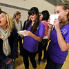 "Zoe Calvin, waits nervously as sorority members Caitlin Carlson, left and Molly Williams hold the envelopes that will give Calvin her sorority assignment in the Glenn Miller Ballroom on the CU Boulder Campus Wednesdy evening on Sorority Bid Day. FOR MORE PHOTOS AND A VIDEO OF BID DAY GO TO  <a href=""http://WWW.DAILYCAMERA.COM"">http://WWW.DAILYCAMERA.COM</a><br /> Photo by Paul Aiken / The Camera / September 7, 2011"