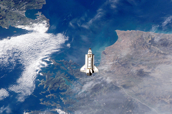 FILE - This Monday, Nov. 25, 2002 file picture shows the space shuttle Endeavour over New Zealand as it approaches the International Space Station for docking. (AP Photo/NASA)