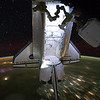 FILE - This Saturday, May 28, 2011 photo provided by NASA shows the Endeavour with a nighttime view of the Earth and a starry sky, while docked at the International Space Station during the Endeavour's final mission. (AP Photo/NASA)