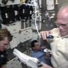 FILE - In this Saturday, Oct. 31, 1998 image made from video provided by NASA, U.S. Sen. John Glenn, right, speaks to mission control during an experiment, assisted by astronaut Scott Parazynski, left, as Spanish astronaut Pedro Duque eats from a food packet aboard the space shuttle Discovery. (AP Photo/NASA TV)