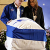 FILE - In this Feb. 10, 2003 file photo, Rona Ramon, widow, right, and Assaf Ramon, left, eldest son of Israel's first astronaut Ilan Ramon, pay their respects beside his coffin during a memorial service at Ben Gurion International Airport outside Tel Aviv. Ramon, a 48 year old air force colonel, died with six other astronauts aboard NASA's Columbia space shuttle, which was destroyed as it came through the Earth's atmosphere on Feb. 1, 2003. Assaf wears his father's NASA flight jacket. Assaf Ramon grew up to become an Israeli Air Force pilot like his father. He was killed when his fighter jet crashed during a training exercise in 2009. He was 21. (AP Photo/Paul Hanna, Pool)