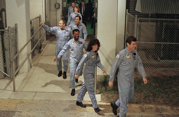FILE - In this Jan. 27, 1986 file picture, the crew for the space shuttle Challenger leaves their quarters for the launch pad at Kennedy Space Center in Cape Canaveral, Fla. From foreground are commander Francis Scobee, Mission Spl. Judith Resnik, Mission Spl. Ronald McNair, Payload Spl. Gregory Jarvis, Mission Spl. Ellison Onizuka, teacher Christa McAuliffe and pilot Michael Smith. (AP Photo/Steve Helber/file)