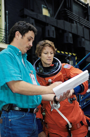 FILE - In this Sept. 12, 2002 file picture, astronaut Eileen Collins, commander for the space shuttle Discovery mission scheduled for May 2005 launch, is briefed by crew trainer Ken Trujillo during a training session in the Space Vehicle Mockup Facility at Johnson Space Center in Houston. (AP Photo/NASA)