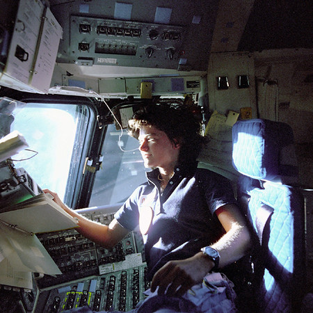FILE - In this June 1983 photo provided by NASA, astronaut Sally Ride, a specialist on shuttle mission STS-7, monitors control panels from the pilot's chair on the shuttle Columbia flight deck. Ride became America's first woman in space when Columbia launched June 18, 1983. (AP Photo/NASA/File)