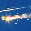 FILE - In this Saturday, Feb. 1, 2003 file photo, debris from the space shuttle Columbia streaks across the sky over Tyler, Texas. (AP Photo/Dr. Scott Lieberman)