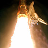 FILE - In this Friday, July 23, 1999 picture provided by NASA, flaming exhaust thrusts from the solid rocket boosters and main engines of the space shuttle Columbia as it launches from the Kennedy Space Center in Cape Canaveral, Fla. into the night sky. (AP Photo/NASA)