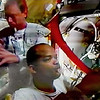 FILE - In this Monday, Dec. 18, 2006 image made from video provided by NASA, Swedish astronaut Christer Fuglesang, left, and astronaut Robert Curbeam, right, prepare for a space walk. (AP Photo/NASA)