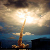 FILE - In this Friday, March 1, 2002 file picture, the space shuttle Columbia illuminates a cloud during its morning liftoff at the Kennedy Space Center in Cape Canaveral, Fla. (AP Photo/NASA, Anita Barrett)