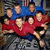 FILE - This photo provided by NASA in June 2003 shows STS-107 crew members in the SPACEHAB Research Double Module (RDM) aboard the Space Shuttle Columbia. On Feb. 1, 2003, the seven crew members were lost as the Columbia fell apart over East Texas. This picture was on a roll of unprocessed film later recovered by searchers from the debris. From the left (bottom row), wearing red shirts to signify their shift's color, are astronauts Kalpana Chawla, mission specialist; Rick D. Husband, mission commander; Laurel B. Clark, mission specialist; and Ilan Ramon, payload specialist. From the left (top row), wearing blue shirts, are astronauts David M. Brown, mission specialist; William C. McCool, pilot; and Michael P. Anderson, payload commander. Ramon represents the Israeli Space Agency. (AP Photo/NASA, File)