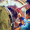 FILE - In this Monday, June 8, 1998 image made from video provided by NASA, Russian space station Mir cosmonauts Nikolai Budarin, top right, and Talgat Musabayev say goodbye to the crew of the space shuttle Discovery as they close the hatch linking the two spacecraft before undocking. Discovery was the ninth and last shuttle to dock with Mir. (AP Photo/NASA TV)