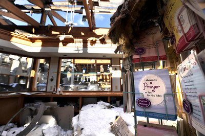 A few greeting cards remain unscathed in the St. Malo Retreat Center's gift shop as sunshine streams through what used to be the roof of the building. The center's mainlodge caught fire, starting in the ceiling, on November 14. For more photos go to www.dailycamera.com Photo by Walt Hester | Trail Gazette