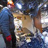 "Jeff Rivar, operations manager for the St. Malo Retreat Center tours the third floor of the center's main lodge on Tuesday. The building's chapel, right, housed a morning mass when the building caught fire on November 14.<br /> For more photos go to  <a href=""http://www.dailycamera.com"">http://www.dailycamera.com</a><br /> Photo by Walt Hester 