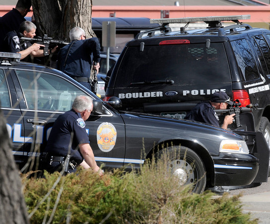 Police surround a man at Boulder Community Hospital in Boulder on Monday, April 4, 2011. Phil McMichael / The Camera