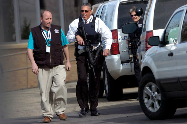 Officers leave the scene of a standoff at Boulder Community Hospital on Monday April 4, 2011.<br /> Photo by Paul Aiken