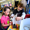 KRISTOPHER RADDER — BRATTLEBORO REFORMER<br /> Natalie Cutler (left), and Patrcik Carroll (right), put the final touches on their vehicle as students at Wardsboro Elementary School test out their sail cars that they built during STEAM time on Oct. 28, 2019.