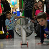 KRISTOPHER RADDER — BRATTLEBORO REFORMER<br /> James Knapp watches one of the sail cars travel down the hall as students at Wardsboro Elementary School test out their sail cars that they built during STEAM time on Oct. 28, 2019.