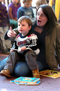 Henry Van Renen and his mother Maria listen to Melanie Howard read children's books during Storytime for Kids at the Boulder Public Library Main Branch on Wednesday November 24, 2010. For more photos and a video of Storytime go to www.dailycamera.com