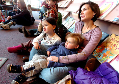 From left to right Zoey, 3, Tyler, 2 and their mother Melissa Perrine listen to Melanie Howard read children's books during Storytime for Kids at the Boulder Public Library Main Branch on Wednesday November 24, 2010. For more photos and a video of Storytime go to www.dailycamera.com