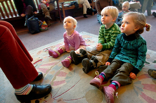 """From left to right Willow Gilmartin, 1 and 1/2, her brother Griffin Gilmartin, 3, and Lola Dean Clark listen to Melanie Howard read stories during Storytime for Kids at the Boulder Public Library Main Branch on Wednesday November 24, 2010.<br /> For more photos and a video of Storytime go to  <a href=""""http://www.dailycamera.com"""">http://www.dailycamera.com</a>"""