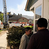 Hadi Hashmi, at right, talks to some friends while firefighters work to put out a structure fire at the Summit Condominiums building at 2855 Rock Creek Circle in Superior. Hashmi's condominium was one of the units that were destroyed in the fire. Hashmi's 13-year-old daughter was babysitting her 2-year-old sister and was able to call 911 and evacuate before anyone was seriously injured.<br /> Jeremy Papasso/ Camera