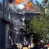 Firefighters work against a fire in Superior on <br /> Thursday afternoon<br /> Photo by Paul Aiken /  August 26, 2010.