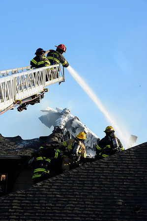 Firefighters work to put out a structure fire at the Summit Condominiums building at 2855 Rock Creek Circle in Superior.<br /> Jeremy Papasso/ Camera