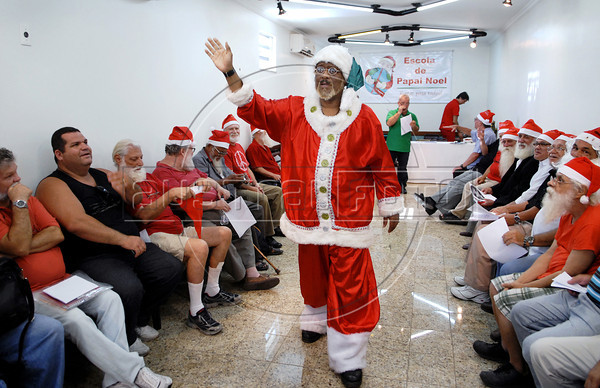 Men assist at Escola de Papai Noel (Santa Claus school), Rio de Janeiro, Brazil, October 25, 2011. The students learn to sing, relations with childs, how to dress. (Austral Foto/Renzo Gostoli)