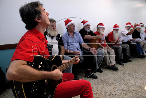 Men students sing at Escola de Papai Noel (Santa Claus school), Rio de Janeiro, Brazil, October 25, 2011. The students learn to sing, relations with childs, how to dress. (Austral Foto/Renzo Gostoli)