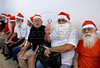 Men students assist at Escola de Papai Noel (Santa Claus school), Rio de Janeiro, Brazil, October 25, 2011. The students learn to sing, relations with childs, how to dress. (Austral Foto/Renzo Gostoli)