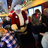 KRISTOPHER RADDER — BRATTLEBORO REFORMER<br /> Santa rides the train back to Bellows Falls as he meets and takes photos with people riding the Santa Express on Sunday, Nov. 18, 2018.